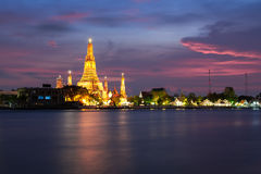 The beautiful temple along the Chao Phraya river. At twilight Royalty Free Stock Photo