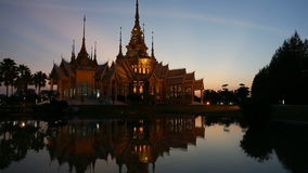 Beautiful temple in twilight time. At Wat Non Kum Nakhon ratchasima Thailand with shadow reflection on water stock video footage