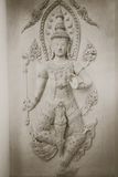 Beautiful of temple wall art depicting male deity . Stock Photo