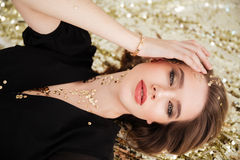 Beautiful tempting young woman with sequins on her face Royalty Free Stock Photography