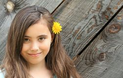 Beautiful ten year old child with dandelion flower Stock Images