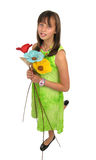 Beautiful ten year old girl with flowers Stock Images