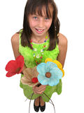 Beautiful ten year old girl with flowers Royalty Free Stock Images