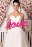 Beautiful tender bride in elegant wedding dress stock image