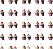 Beautiful tender bright graphic delicious tasty chocolate yummy summer dessert cupcakes with red cherry strawberry pattern Stock Photography