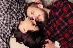 Beautiful tender couple in casual clothes, relaxing at home Stock Images