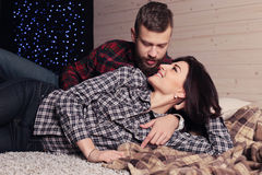 Beautiful tender couple in casual clothes, relaxing at home Stock Photo