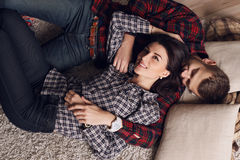 Beautiful tender couple in casual clothes, relaxing at home Royalty Free Stock Images