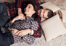 Beautiful tender couple in casual clothes, relaxing at home Royalty Free Stock Image