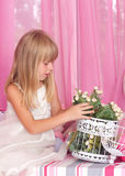 Beautiful tender girl i holds bouquet of flowers Stock Images