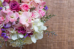 Beautiful tender wedding bouquet of cream roses and eustoma flowers in hands of the bride Stock Photography