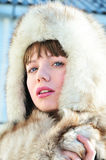 Beautiful tender  woman in fur hat Stock Image