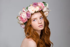 Beautiful tender woman with long hair in wreath of flowers Stock Photo