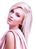 Beautiful tender woman with pink silk. Royalty Free Stock Photo