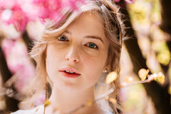 Beautiful tender young woman in blooming garden Royalty Free Stock Photos