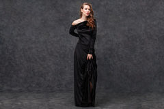Beautiful tender young woman in long evening dress Stock Photography