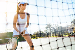 Beautiful tennis player with racket on court Stock Photography