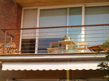 Beautiful terrace or balcony with small table and chairs Stock Images