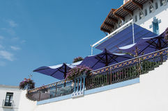 Beautiful terrace with flowers and parasol in front of Stock Images