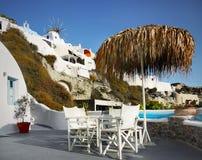 Beautiful Terrace, Santorini Island, Greece. Parasol, chairs and table on beautiful terrace, Santorini island, Greece stock photography