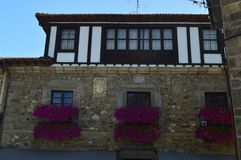 Beautiful Terrace With Some Beautiful Purple Flowers Decorating It In The Villa Of Pots. Nature, Architecture, Travel. July 30, 2018. Potes, Cantabria, Spain stock photo