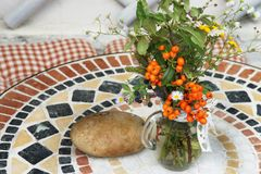 Beautiful terrace with a table and flowers Royalty Free Stock Photo