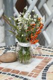 Beautiful terrace with a table and flowers Royalty Free Stock Photography