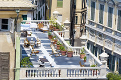 Beautiful terrace  with tables and chairs in Genoa,Italy Stock Image
