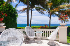 Beautiful terrace with white furniture next to the beach Royalty Free Stock Photos