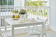 Beautiful terrace with white furniture and tea or coffee set. At home stock photos