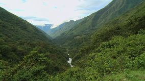 The beautiful terrain and the river. A still birds eye view of the beautiful terrain with the green and lush fields and the tall trees on a warm afternoon stock video
