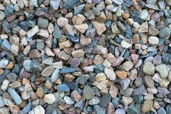 Beautiful texture of colored small stones, background of stones stock photo