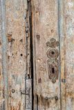 Detail from an old door in Aiud, Romania. Beautiful texture of an old wooden broken door in Aiud, Romania royalty free stock photography