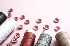 Beautiful Texture With Lots Of Round Red Buttons For Sewing, Needlework And Skeins Of Spools Of Thread. Copy Space. Flat Lay. Royalty Free Stock Photo