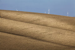 Beautiful textured brown hill with wind turbines Royalty Free Stock Photos