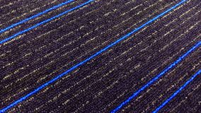 Beautiful textured carpet with blue lines. stock photography