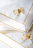 Beautiful textured fabric napkins table decoration. Beautiful white creamy textured fabric napkins with ribbon and bow for table decoration Stock Image