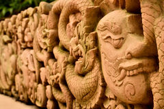 A Beautiful Thai Art. A Thai Arts, the sculpture of Thailand which is ordinarily seen in temples of Thailand. The sculpture shows stories and tells about Royalty Free Stock Photo