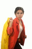 Pretty Asian business woman holding yellow suit on white background. Stock Photos