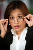 Beautiful Thai businesswoman wearing eyeglasses . Royalty Free Stock Images