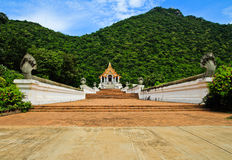 Beautiful thai church in front of the mountain royalty free stock photography