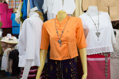 Beautiful Thai dresses on the mannequins. In the shop Royalty Free Stock Photos