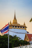 Beautiful Thai flag at front of  Wat Saket Ratcha Wora Maha Wiha. N (Wat Phu Khao Thong, Golden Mount temple), a popular Bangkok tourist attraction and has Stock Image