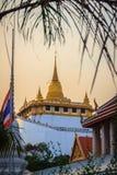 Beautiful Thai flag at front of  Wat Saket Ratcha Wora Maha Wiha. N (Wat Phu Khao Thong, Golden Mount temple), a popular Bangkok tourist attraction and has Royalty Free Stock Photo