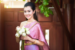 Beautiful Thai girl in Thai traditional costume Royalty Free Stock Image