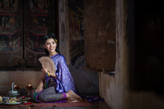 Beautiful Thai girl in Thai traditional costume. Royalty Free Stock Images