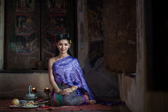 Beautiful Thai girl in Thai traditional costume. Royalty Free Stock Photos