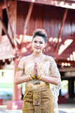 Beautiful Thai girl in Thai traditional costume Stock Photo