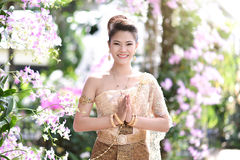 Beautiful Thai girl in Thai traditional costume Royalty Free Stock Photos