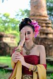Beautiful Thai girl in traditional dress costume in Choeng Tha a. S Thai temple where is the public place, Thai Woman in Traditional Costume of Thailand royalty free stock photography